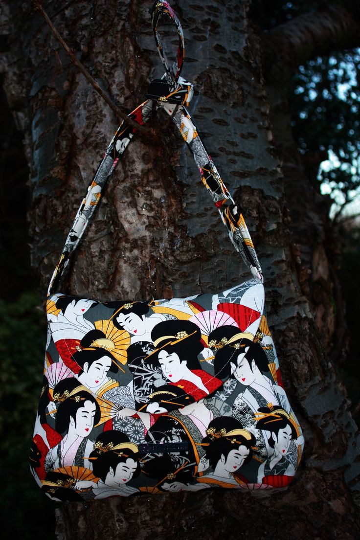 """This is a """"Natalie+"""" bag and it comes with a flap, magnetic fastening and internal pockets. It has along strap, so that it can be used as a """"cross body"""" bag. It is sized appox 300mm x 230mm. Price £32 (+postage £6)"""