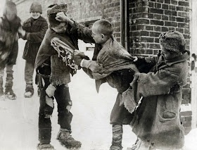 Destitute Russian boys fighting in a Moscow street for a fur cap. (1923)