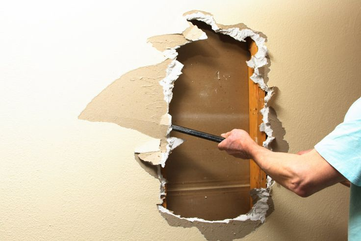 Create in-wall storage by knocking out the drywall and exposing the studs.