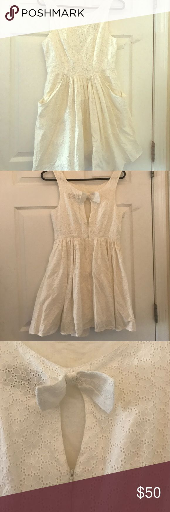 White dress White dress above the knees, bow on the back and a full skirt.  Perfect for Tea Parties Jack Wills Dresses Mini