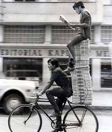 Reading the news while delivering the papers on a bike