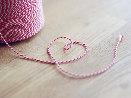 https://flic.kr/p/6Kpo6h | A heart made of baker's twine | Yesterday I bought a big roll of baker's twine. I absolutely love paper goods, so walking into the cute little paper shop in town and buying that enourmous roll felt really nice. It doesn't take more than that to make me happy :)  We've used it for some wedding decoration stuff that I will share with you later. The wedding is only two days away now, and I'm longing for it crazy much :)