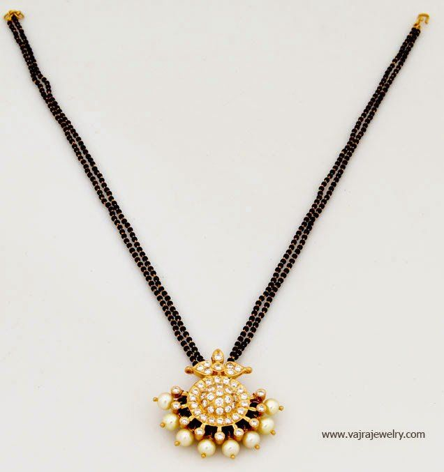 22 carat gold simple short black beads mangalsutra chains with diamond pendants. For inquiries contact: Vajra Jewelry watsapp on 9704300888 Email: info@vajrajewelry.com