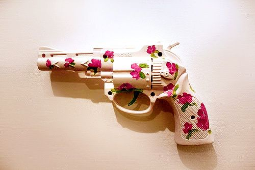 WHY?? This is just cruel and ugly. Who puts flowers on a damn gun? A gun is not for matching the curtains in your freakin living room. #gun