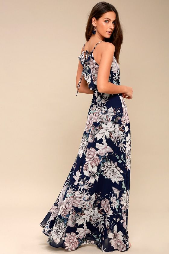 The perfect getaway is at your fingertips in the Something Just Like This Navy Blue Floral Print Maxi Dress! Lightweight woven poly, in a navy blue, white, lavender, and mint floral print, falls from adjustable spaghetti straps, into a surplice bodice. Fitted waist, and wrapping maxi skirt. Ruffled, tying open back. Hidden back zipper.