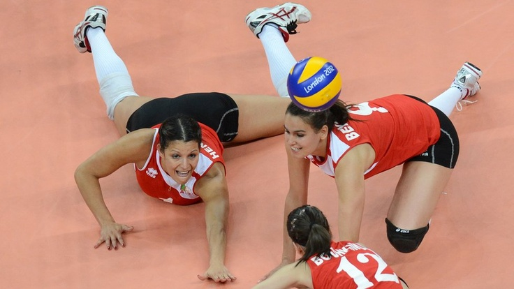 Algeria desperately try to keep the ball alive during their volleyball match with Team GB