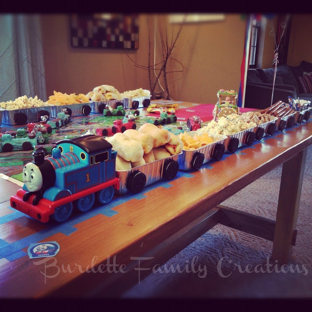 Burdette Family Creations Thomas The Train Birthday Party Using Blue Painters Tape For Tracks Foil Loaf Pans To Hold Food Oreo Cookies As Wheels