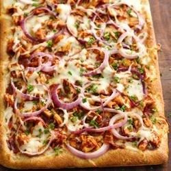 Treat your family to this warm and delicious BBQ chicken pizza that's made using Pillsbury(R) refrigerated artisan pizza crust with whole grain – perfect for dinner.