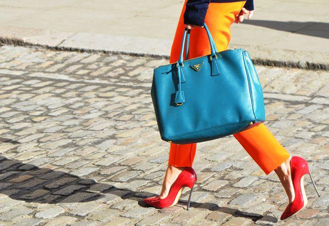 orange pants, red shoes, blue bag