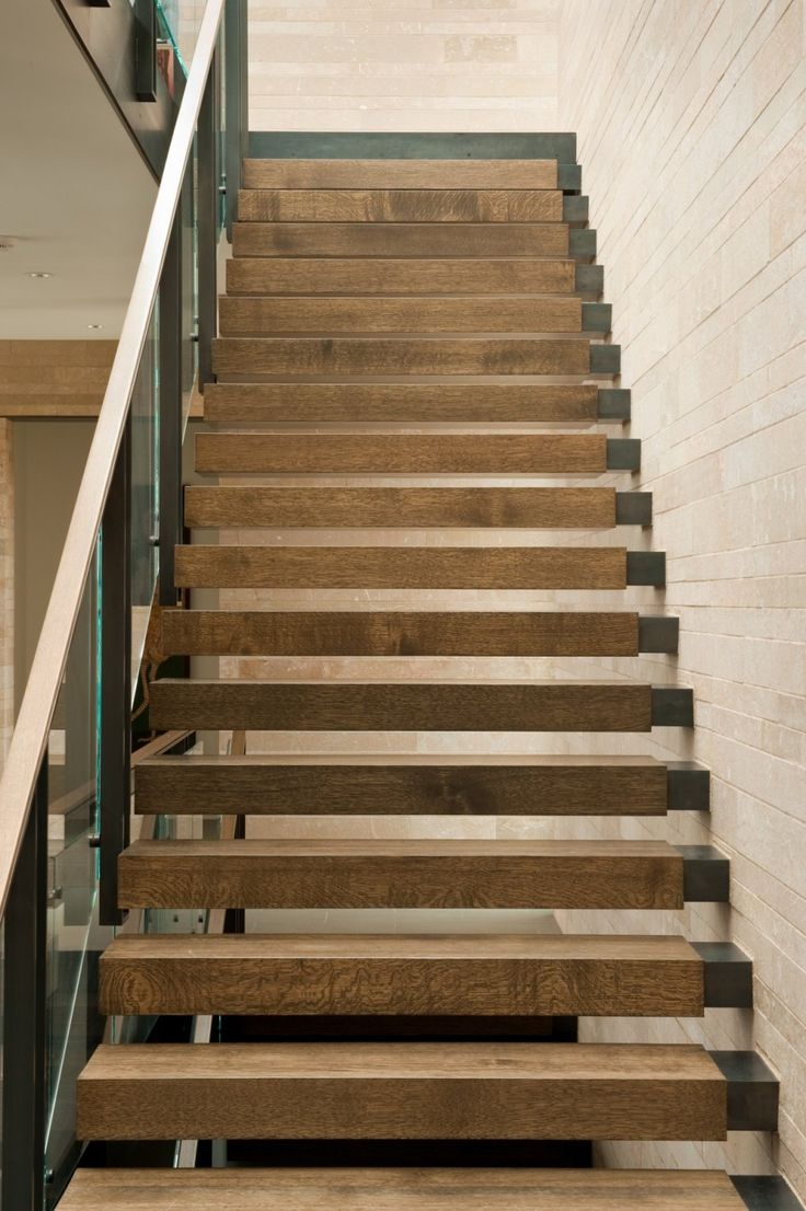 Amazing staircase...beautiful detail with the wood & metal. Washington Park Hilltop Residence.
