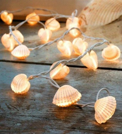 Shell String Lights: http://www.completely-coastal.com/2016/05/beach-nautical-string-lights.html Light up your summer night with shells!