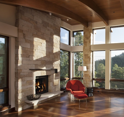 stone fireplace and pillar, clerestory windows, curved wooden ceiling, views - whats not to like