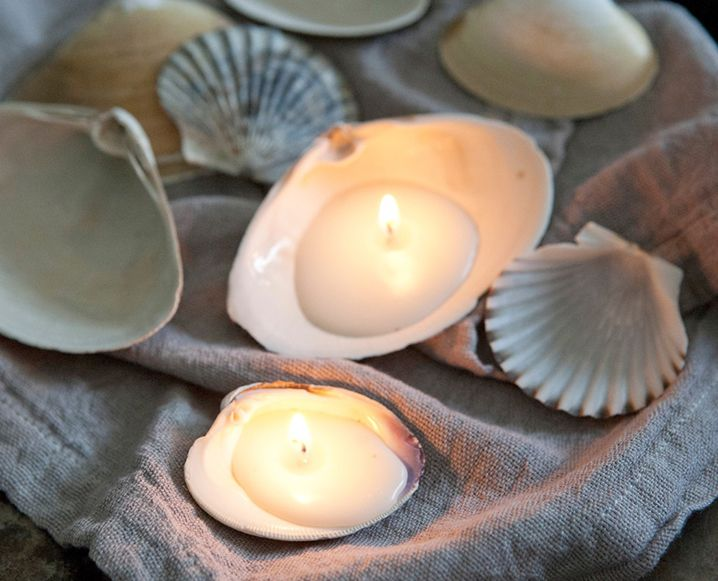 Turn seashells into beautiful shell candles with this easy DIY. They're the perfect centerpiece for your next beach-inspired dinner soirée.
