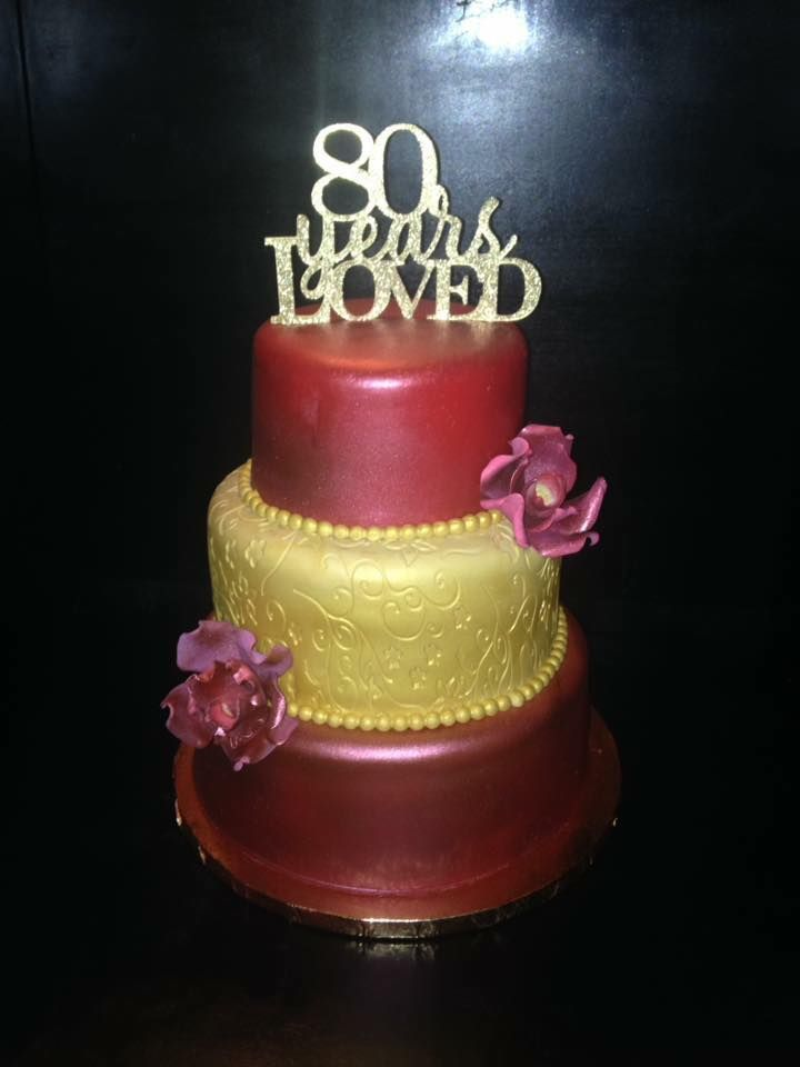 80 th birthday red and gold cake