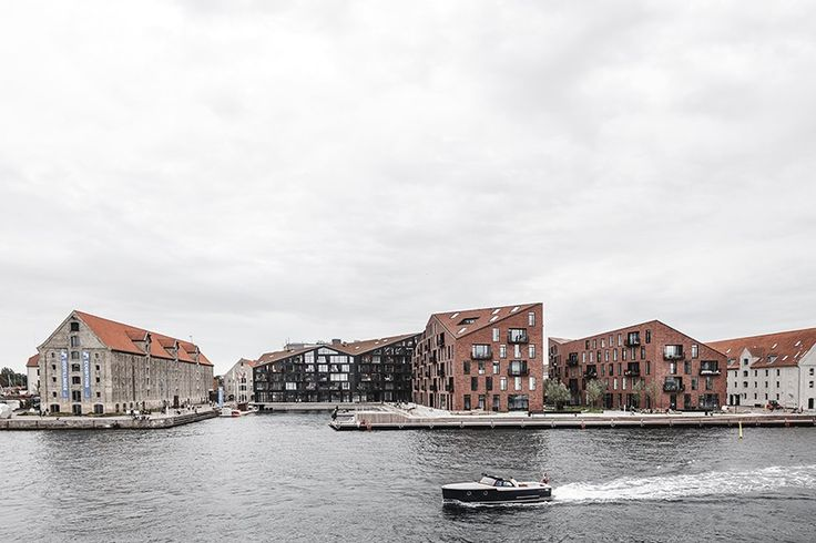 set along the waterfront, a contextual architectural approach shown by the folded roofs and heavy brick expression is sympathetic to the industrial surroundings.