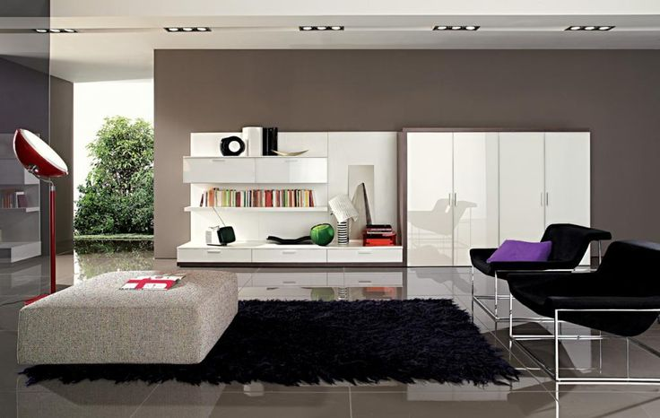 http://www.drissimm.com/wp-content/uploads/2014/10/modern-living-room-design-with-black-furry-rug-on-gray-tile-floor-as-well-black-chair-including-red-lamps-stand-on-floor-as-book-shelves-over-the-drawer-low-vanity-beside-white-cupboard.jpg