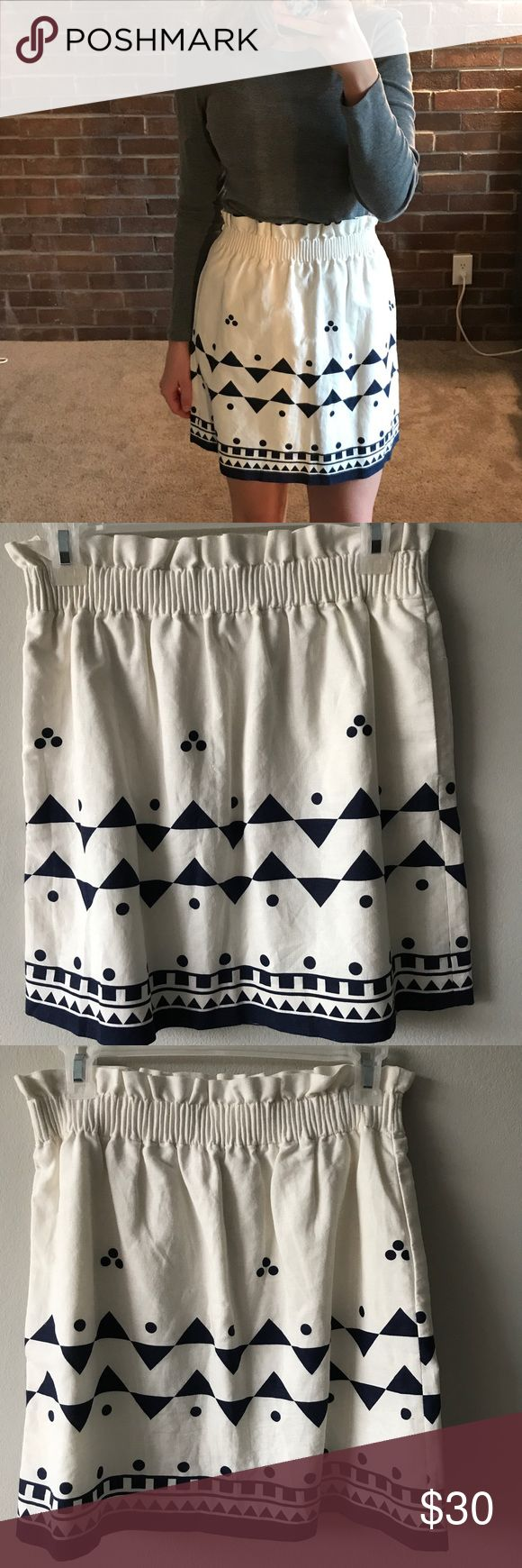 J.crew blue and white skirt White skirt with a dark blue tribal print on the bottom. Great fabric that doesn't wrinkly easily. Only worn a couple of times! J.Crew Factory Skirts Pencil