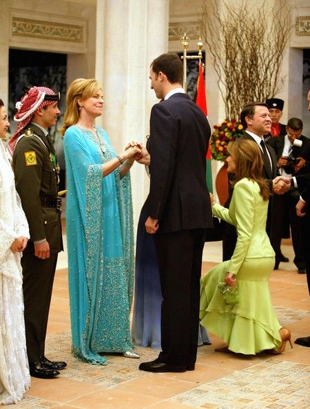Crown Prince Felipe (2nd-R) of Spain and his wife Princess Letizia (R) congratulate Prince Hamzeh's mother Queen Noor (3rd-L) as Crown Princ...
