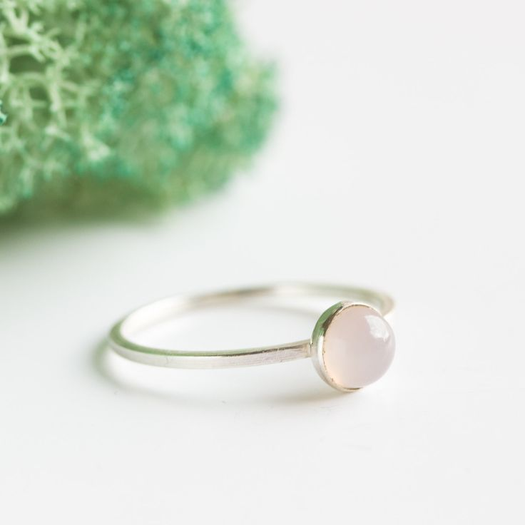 Simple silver ring with pink chalcedony gemstone