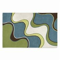 EXCLUSIVE. Sophisticated waves in turquoise, green, brown and natural make a bold statement in any room. This modern rug is sculpted with luxurious 100% wool. Hand-tufted, backed with cotton. Non-skid rug pads are available.