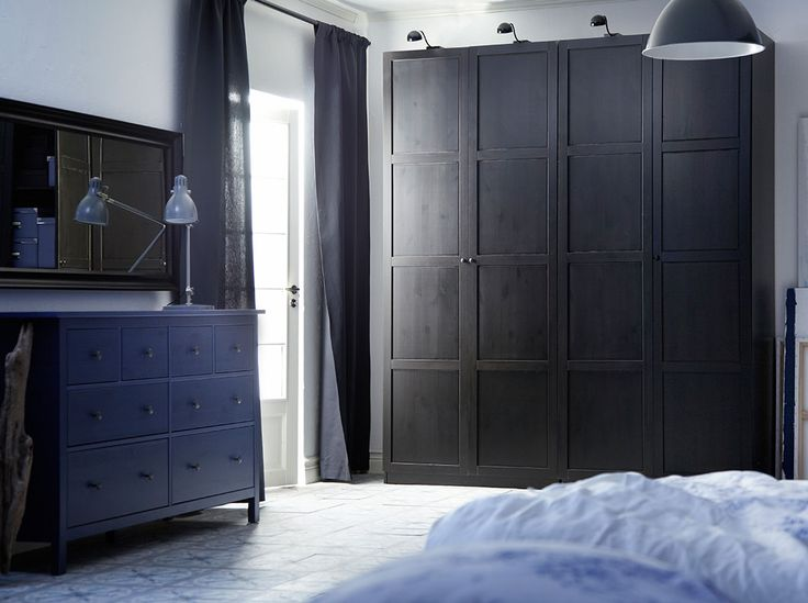 PAX black-brown wardrobe with HEMNES black-brown doors and HEMNES blue chest of drawers and black-brown mirror