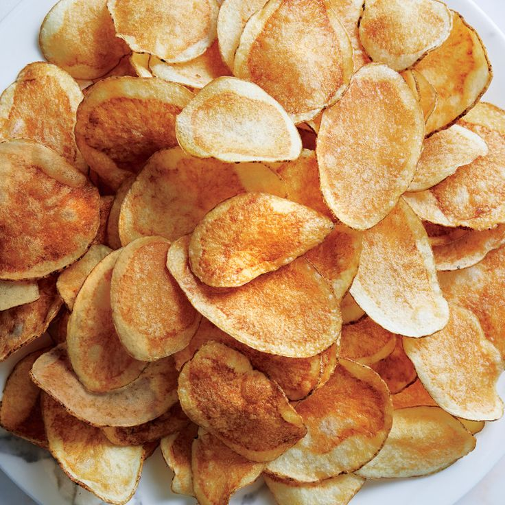 Keys to great chips: A lower frying temp gets the moisture out; a vinegar soak ensures they're crisp.