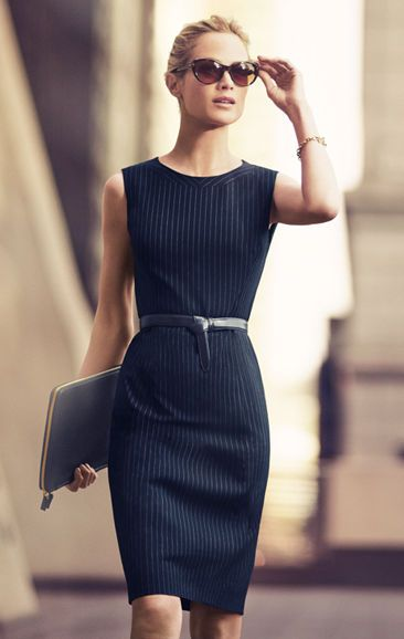 Best Dressed. Mallory sheath dress is an eye-catching design, pure and simple. It has a touch of stretch so it gives in all the right places and it's wrinkle resistant which makes it perfect for business trips. Pair it with a simple strand of pearls and black heels, then take the workplace by storm. Back zip. Navy blue with white pinstripes. Sheath dress.