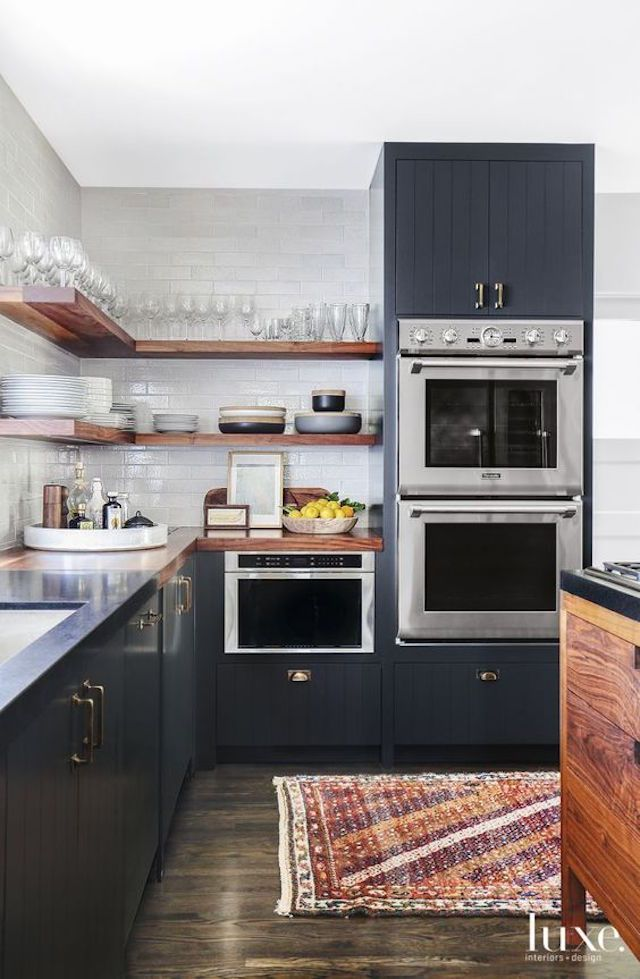 Love the open design here! Open shelving with the separate double oven at  the end to frame the space! And the dark cabinets.
