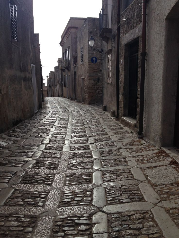 """DAY 10 - sunset walk inErice. We didn't like this hilltown so much, very touristy  and crowded in August. But the ride up the hill on a funicular with a spectacular view and the local patisserie with the excursion (try the warm """"genovesi"""" and the side streets like this one!)"""