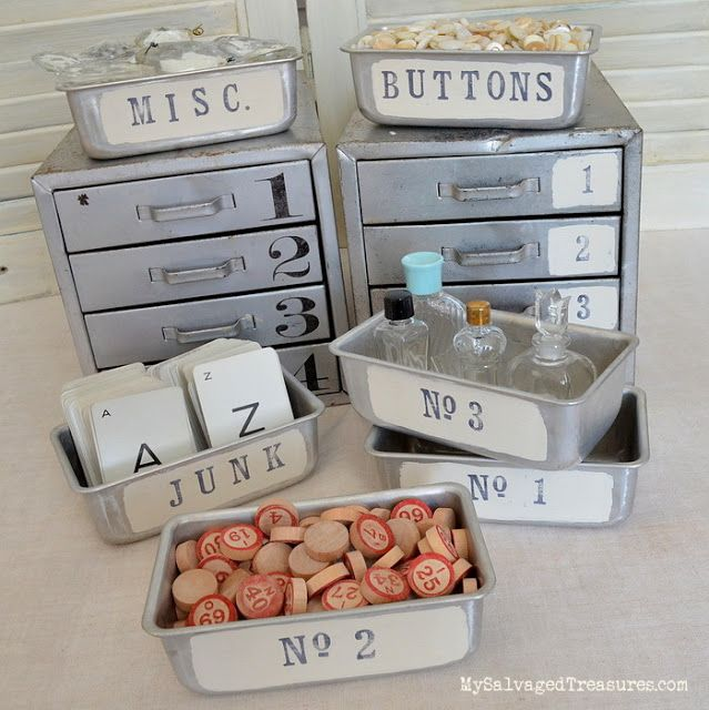 Stamped and stenciled vintage metal storage drawers and little loaf pans. Perfect for storing misc. buttons and other junk. From MySalvagedTreasures.com
