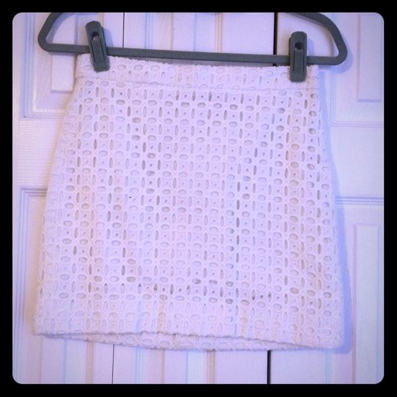 """J. Crew Women's White Eyelet Skirt Size 0 J. Crew Women's White Eyelet Skirt Size 0. Fits true to size. Zips in the back and has a clasp at the top. No rips, snags, stains or tears. I'm 5' 2"""" and this skirt hits about three inches above my knee. J. Crew Skirts Mini"""