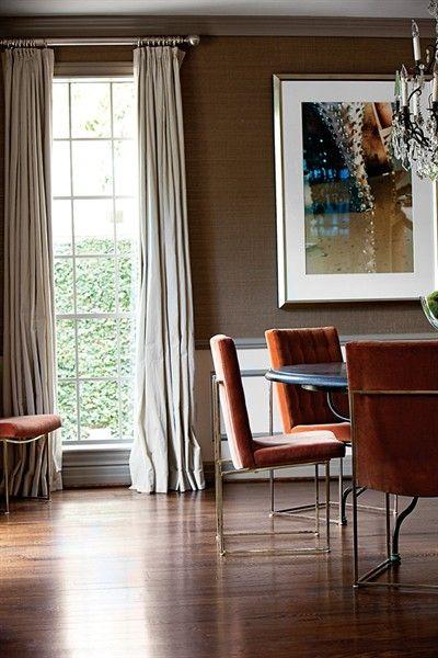 Warm Dining Room | Orange Velvet Chairs | Grasscloth | Brass