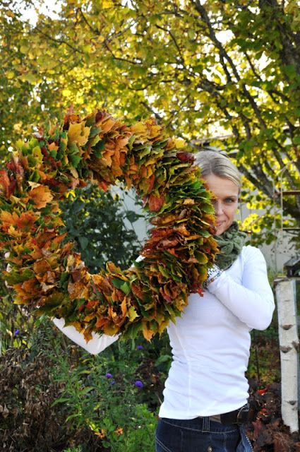 Leaf wreath. Just bend a strong wire into a circle and thread leaves onto it.