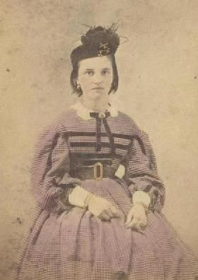 The Barrington House Educational Center, L.L.C.---- Lovely pork pie style hat, trimmed dress, bowtie and belt!  Tinted very nicely as well.