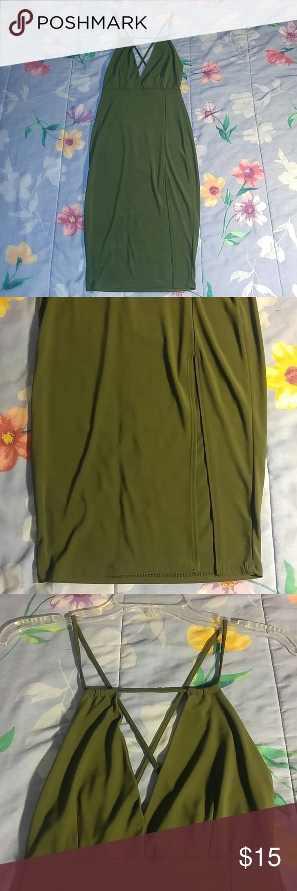 NWOT Sexy dark forest green bodycon dress Sexy slit on the left side, v cut on the chest and criss cross on the back  Perfect for going out/clubbing!!  Bought it but never wore it   96% polyester 4% spandex Forever 21 Dresses