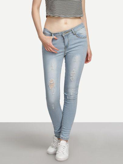 Jeans moulants effet déchiré - bleu