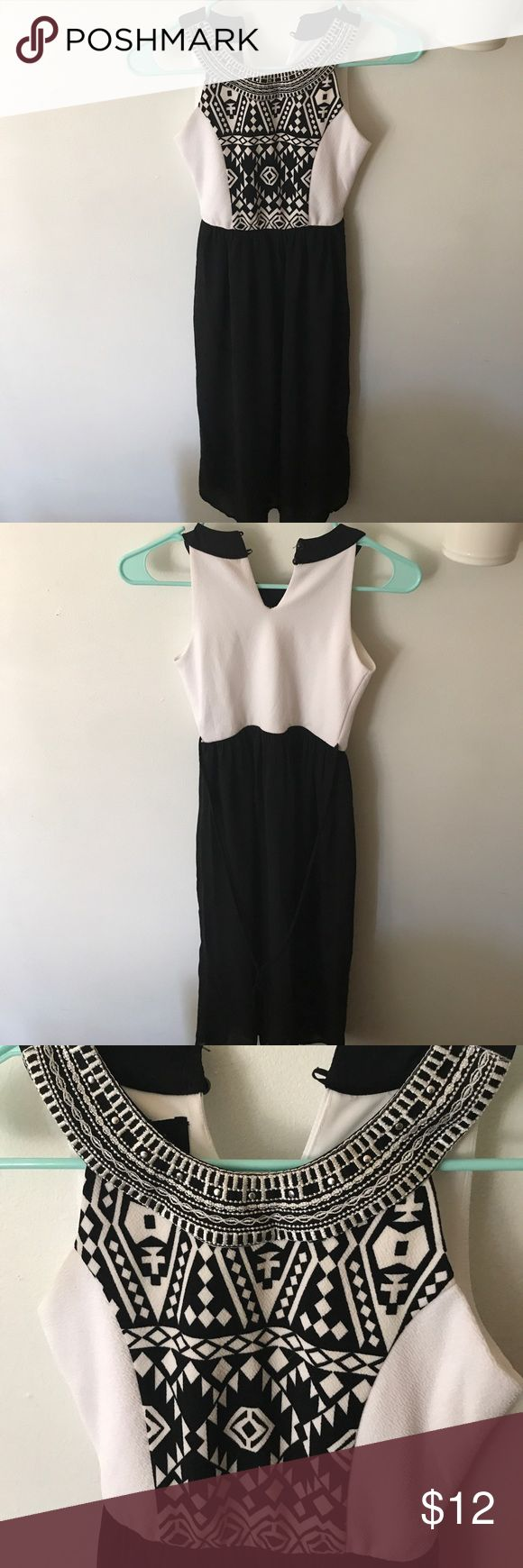 Girls Black and white dress Black and white dress size 7 for girls. Aztec print on top. Dress goes to about knee length and has sheer black slip over top. Ties in the back Amy Byer Dresses Formal