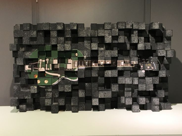 Green guitar on an EPS panel. Made through Hot wire cutting (HTC).