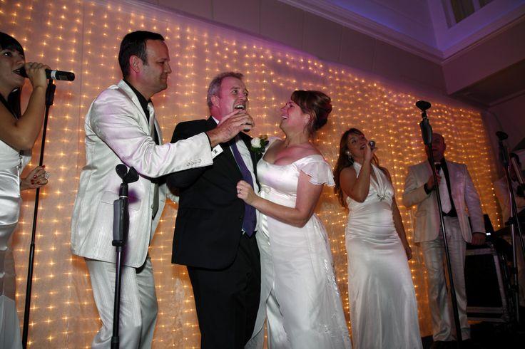 A bride and Groom serenade the guests