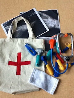 medical bag DIY ~ love the idea of having several totes hanging in dramatic play…
