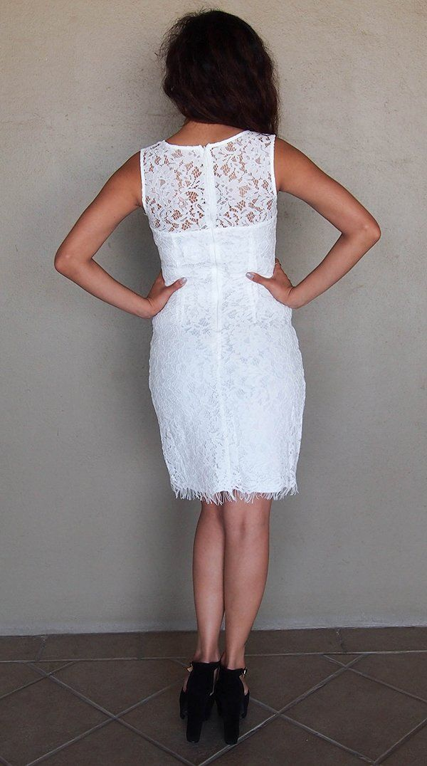 e14db510ed5c The Remarklable White Lace Midi Dress is the perfect dress for any occasion.  White floral lace overlay falls from a sheer rounded scoop neckline to  create ...