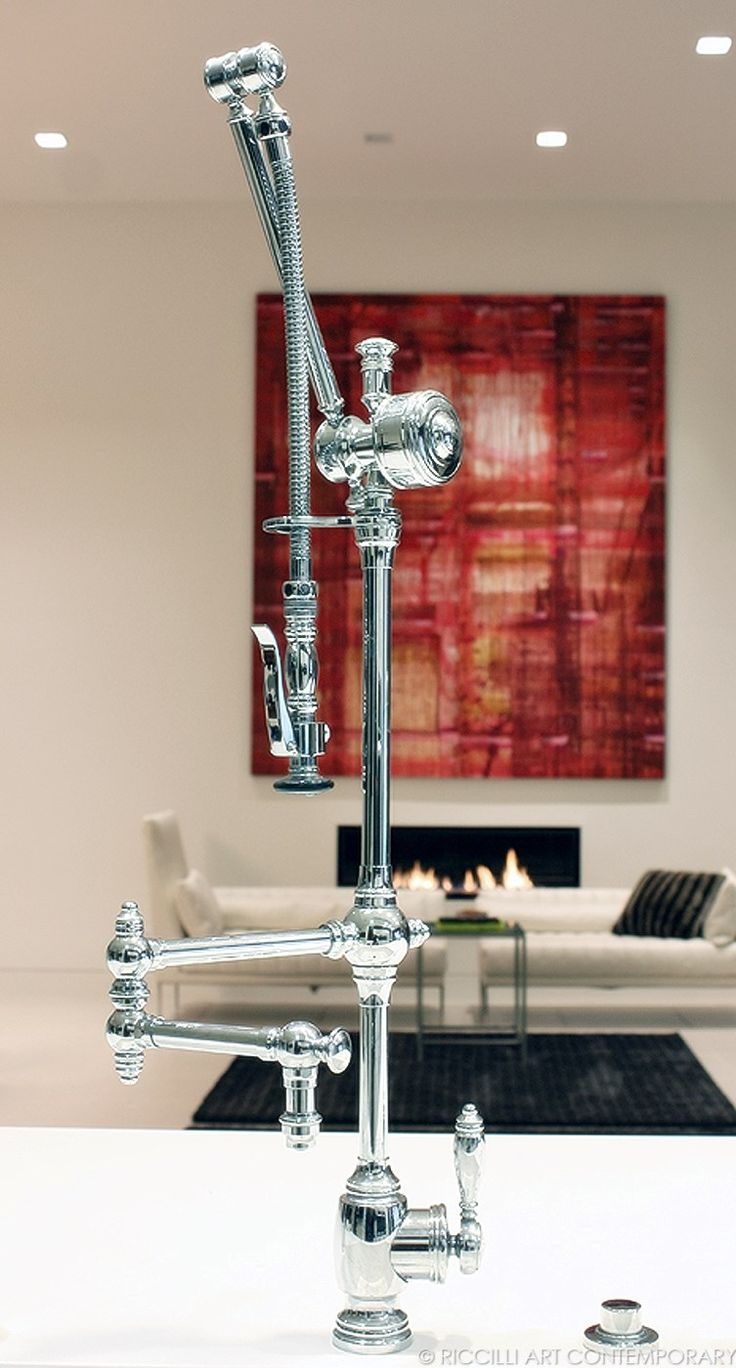Finding great kitchen and bathroom cabinetry was a top priority for interior designer Kathy Monarch when working on a $6 million project in Palo Alto, CA. This incredible gantry faucet is from Watersone. Photo by Morgan Riccilli Slade. Painting by Lea Feinstein.