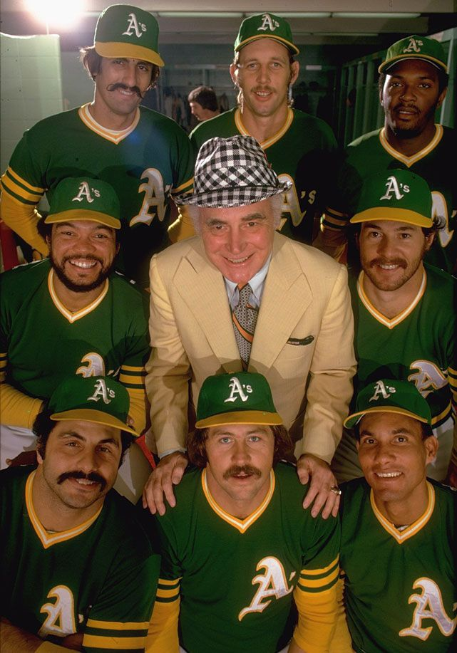 Oakland A's owner Charles O. Finley (center) poses with (clockwise from top L-R) Rollie Fingers, Joe Rudi, Vida Blue, Gene Tenace, Bert Campaneris, Jim Catfish Hunter, Sal Bando & Reggie Jackson during a 1974 SI photo shoot. (Neil Leifer/SI)  SI VAULT: Everyone is in awe of Reggie Jackson (7.17.74): Vida Blue, Jim Catfish, Catfish Hunters, Sal Bando, Joe Rudi, Gene Tenac, Bert Campaneri, Rolli Fingers, Reggie Jackson