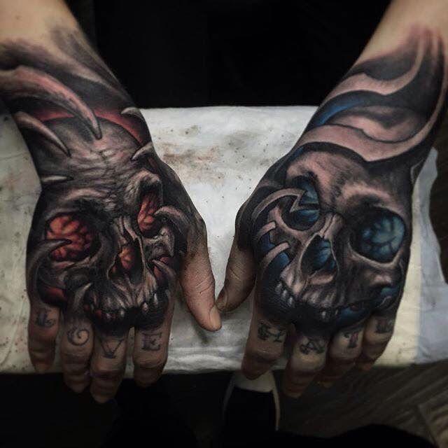 Skull design - on left hand w/ blue