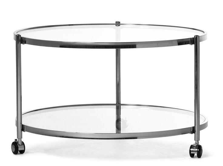 Runt soffbord med hjul som gör bordet lätt att flytta. Underrede i rostfritt stål och skiva i glas. Underhylla i glas med möjligheter till öppen och lättåtkomlig förvaring. Köp gärna till sidobord i samma serie.