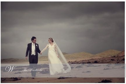 The happy couple take a stroll along the beach,the Lodge at Doonbeg GC