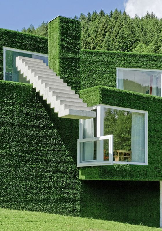 Homes covered with UNUSUAL GREEN material, astroturf.  You'd have to recarpet the exterior every so often.  RESIDENCE