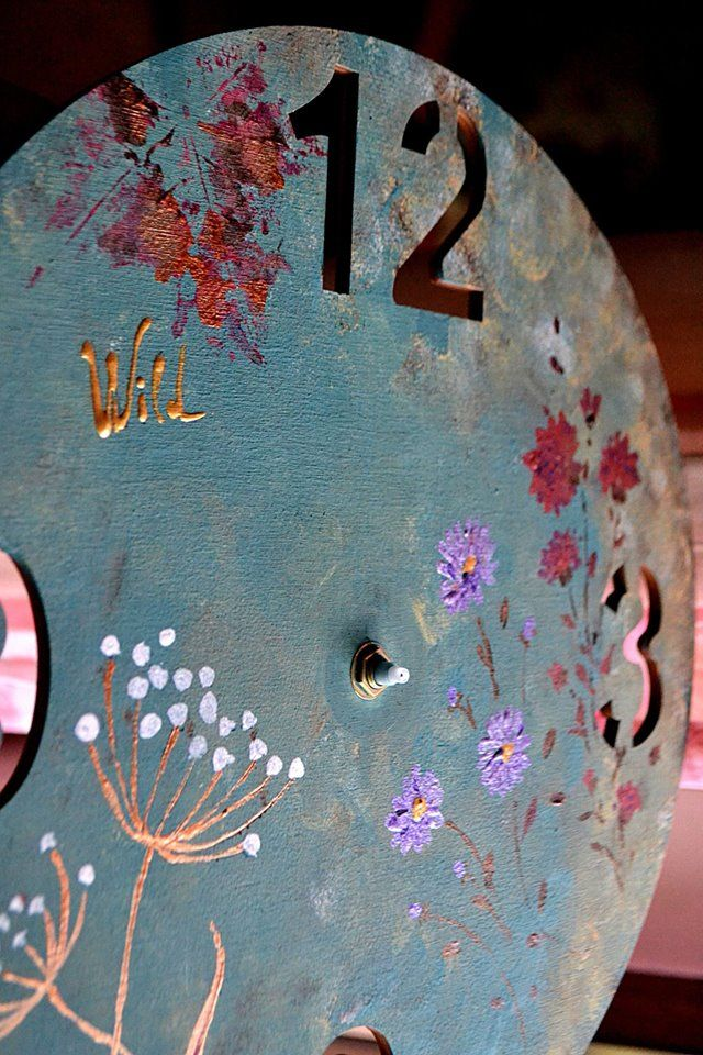 Panted wooden wall clock
