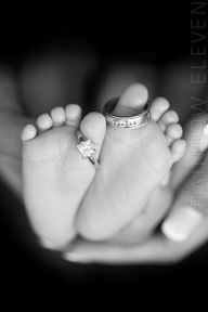 mom and dad's wedding rings on baby's feet