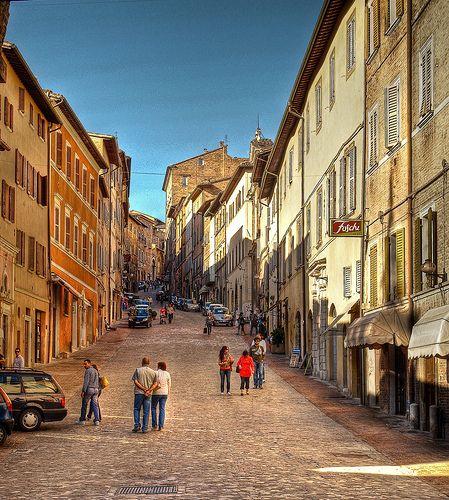 Evening strollers in the Via Mazzini. Urbino, Italy